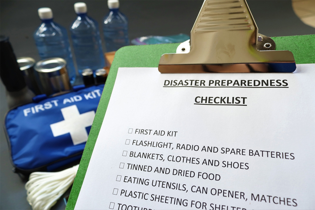 Property manager preparing for natual disasters with emergency kit
