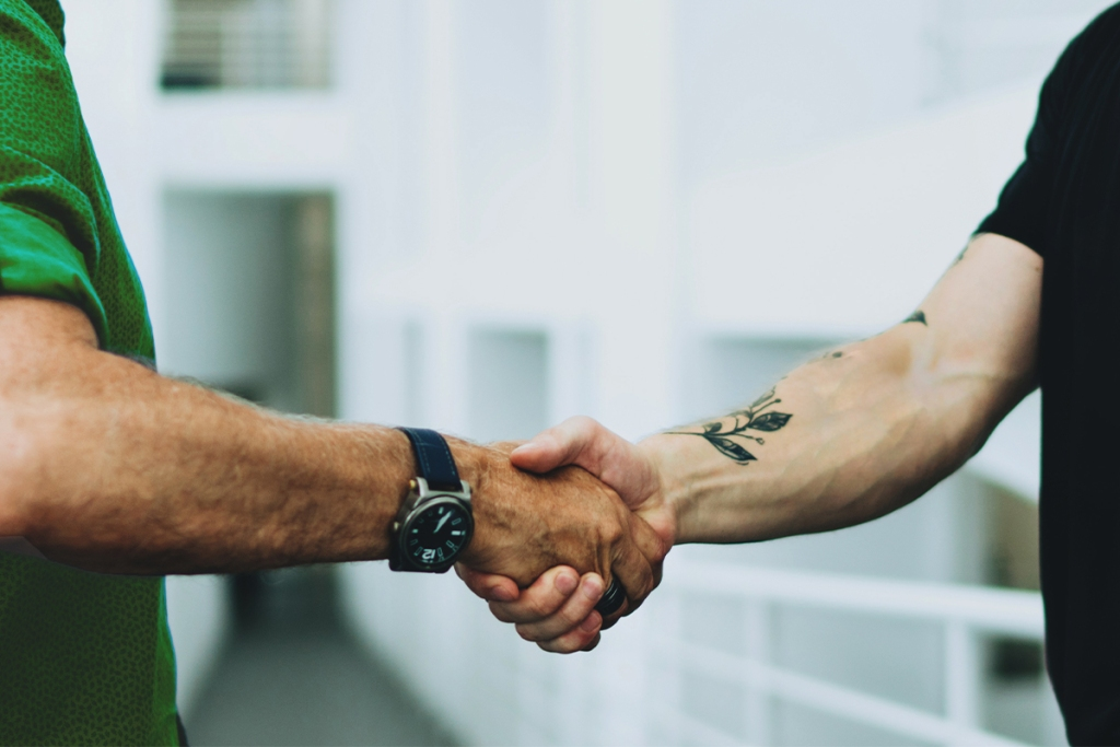 Property manager and tenant are shaking hands, resolving an issue without eviction