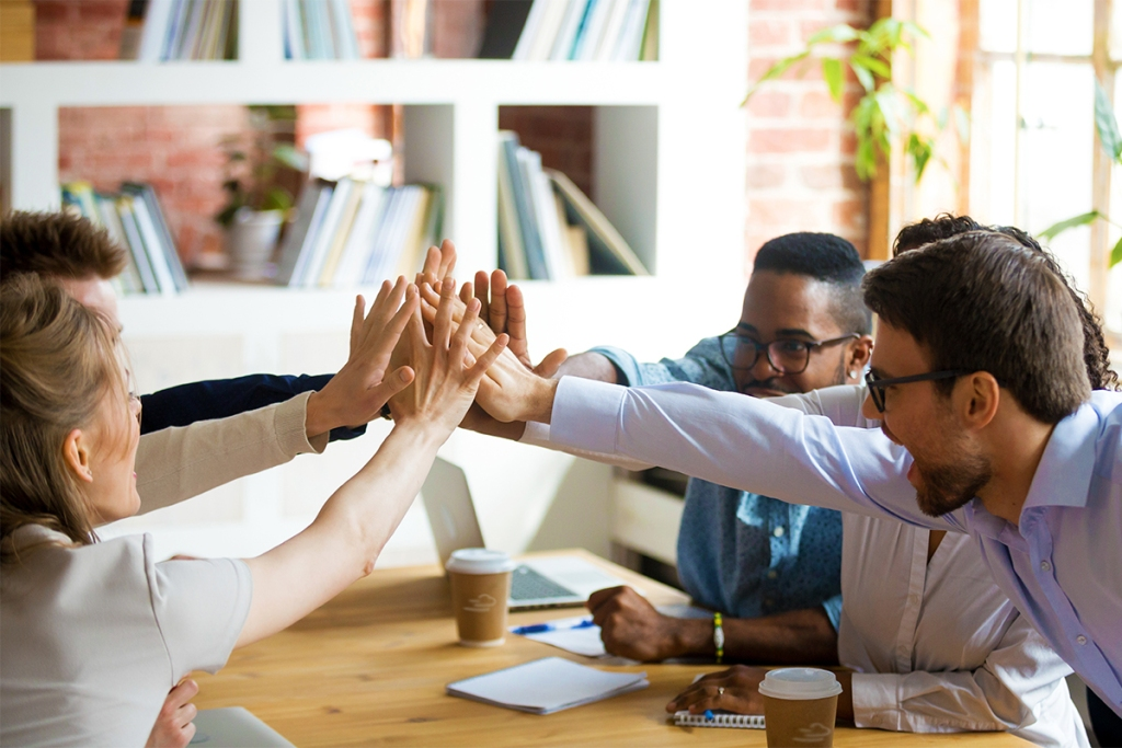 Property management software helping a team give high fives