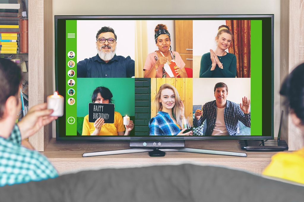 8 residents celebating a special event virtually, practicing social distancing