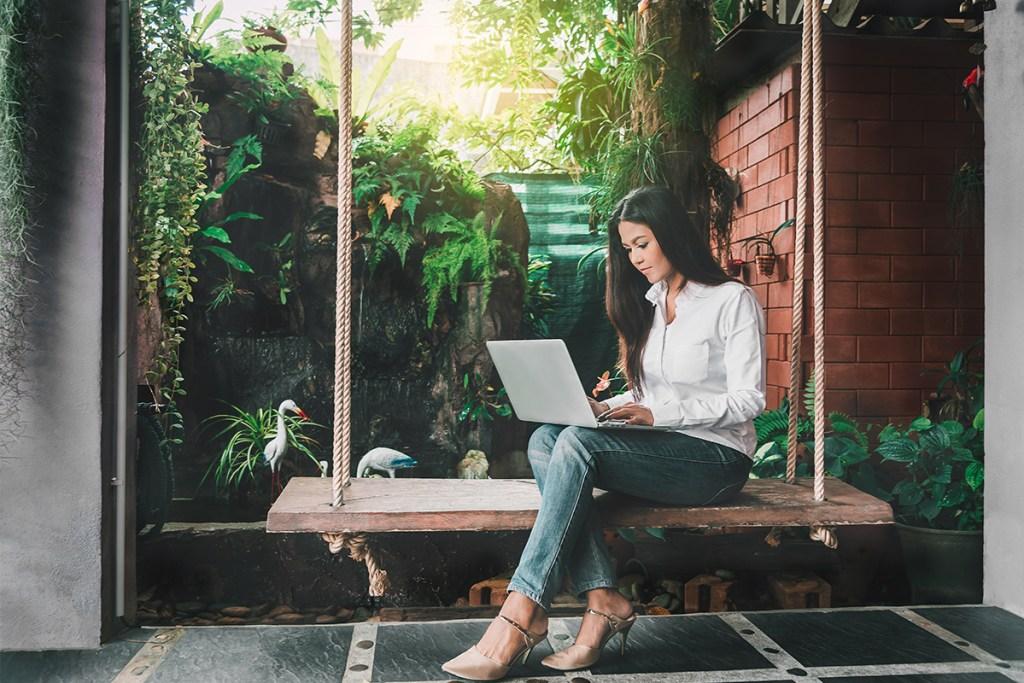 Independent rental owner (IRO) managing properties on laptop