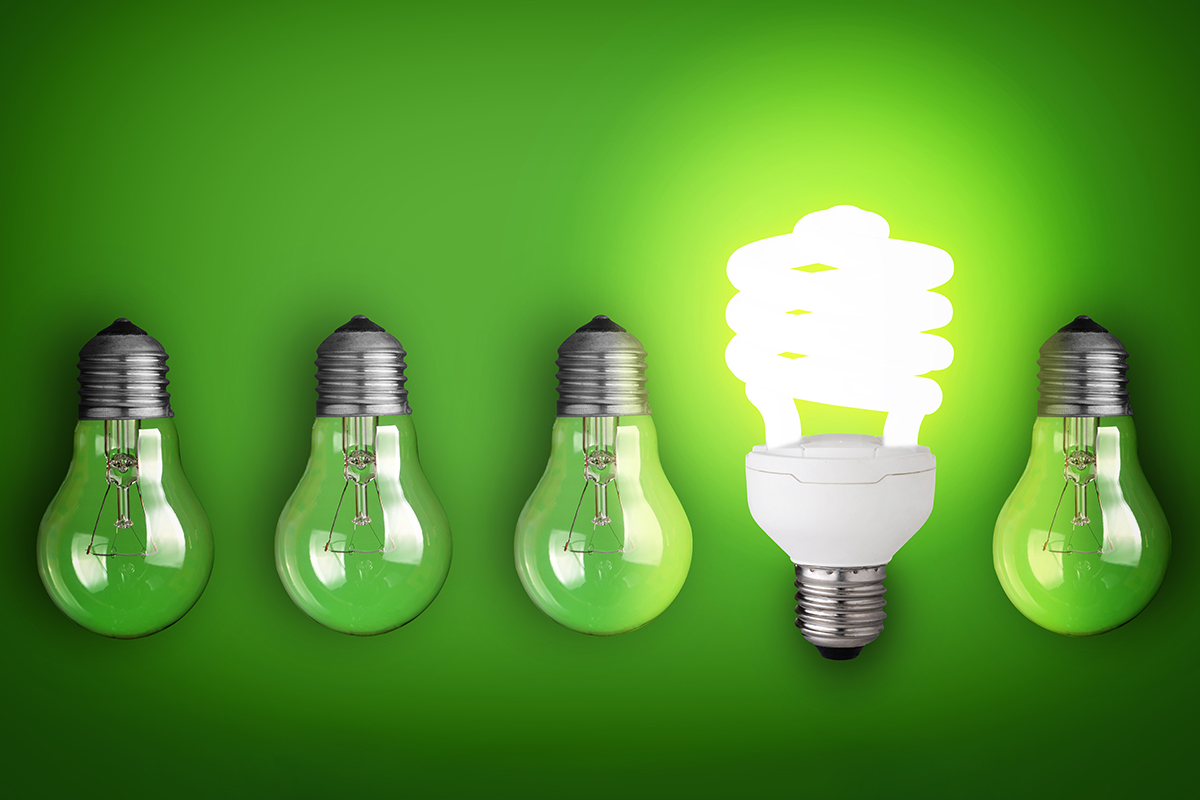 Five green lighbulbs with one lit up showing how one LED light can save energy at your properties