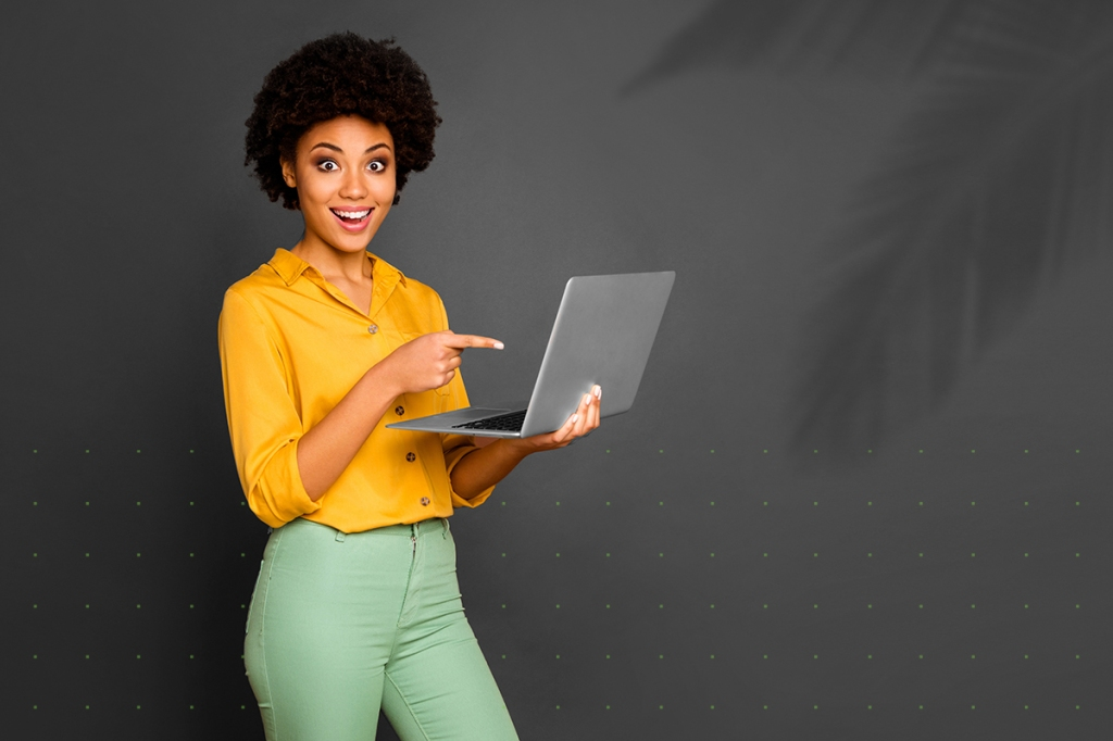 Excited woman supercharging her property management business with a laptop and property management software