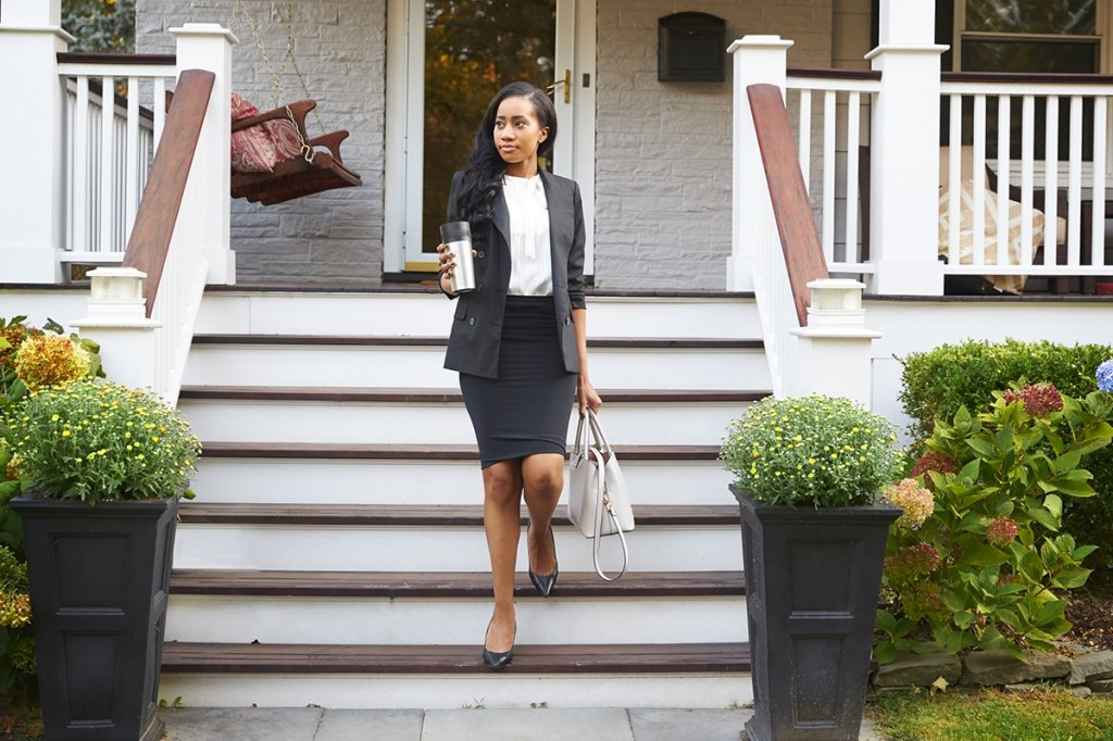 Woman stepping out of home